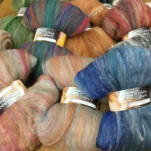 Drum carded butterfly shaped batts